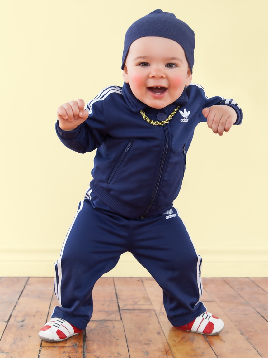 baby in adidas tracksuit