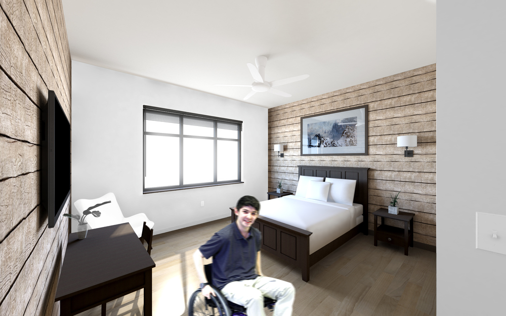 """Dixie Lodge """"Alps Suite"""" with workstation, kitchenette, and roll-in shower."""