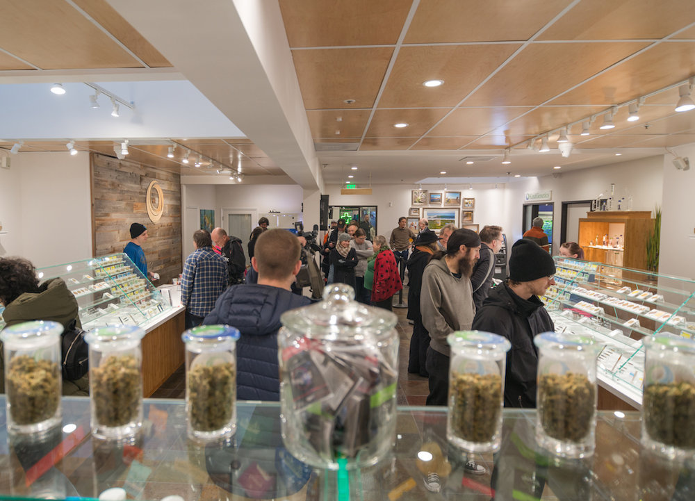 Peoples crowd the interior of KindPeoples location at 140 Dubois Street in Santa Cruz, excited to do their first fully legal cannabis shopping.