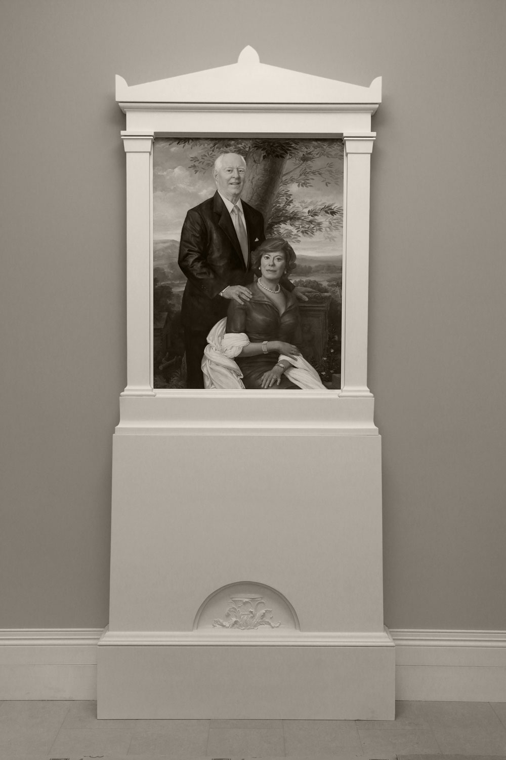 Matthew and Joyce Walsh  2018, Oil on linen, 42 x 32 inches. Collection of the University of Notre Dame · All rights reserved, used with permission.  Leonard Porter (in collaboration with John Simpson Architects )  Aedicule Frame with Bas relief Lunette  2018, Wood and Traditional Gesso, 108 x 48 1/2 inches. Collection of the University of Notre Dame · All rights reserved, used with permission.  Lunette by Emily Bedard. Fabrication by Rhonda Feinman.