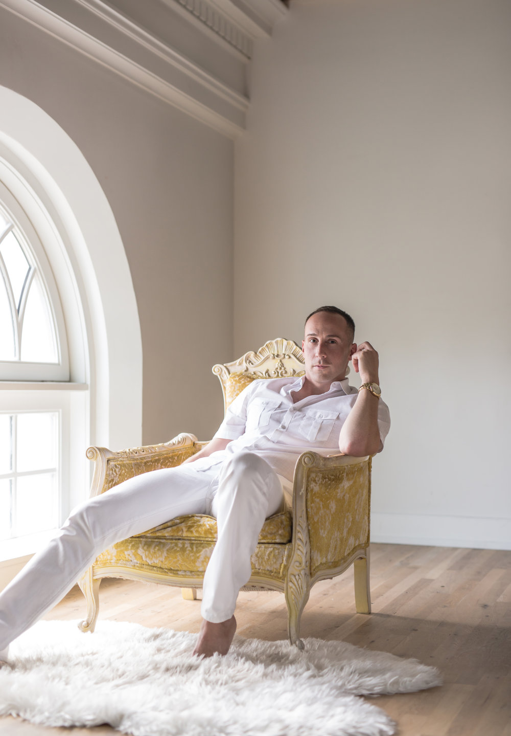 "Nick brought several outfits. One look was to be a light and airy ""Hamptons chic"" look. I went minimalist in my space to really achieve that. The antique chair lent a pop of color.  (c) 2018 Cate Scaglione 