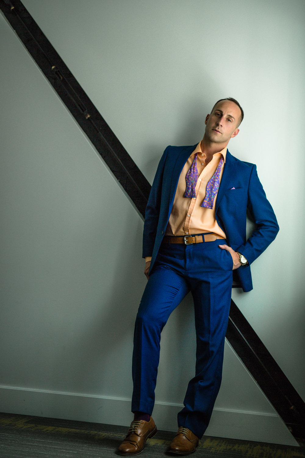 This is our storytelling hint of sexy — without him needing to be in a state of undress to tell that story. Note the bow tie…and a bit of confident swagger in his pose.  (c) 2018 Cate Scaglione | LifeasFineArt.com