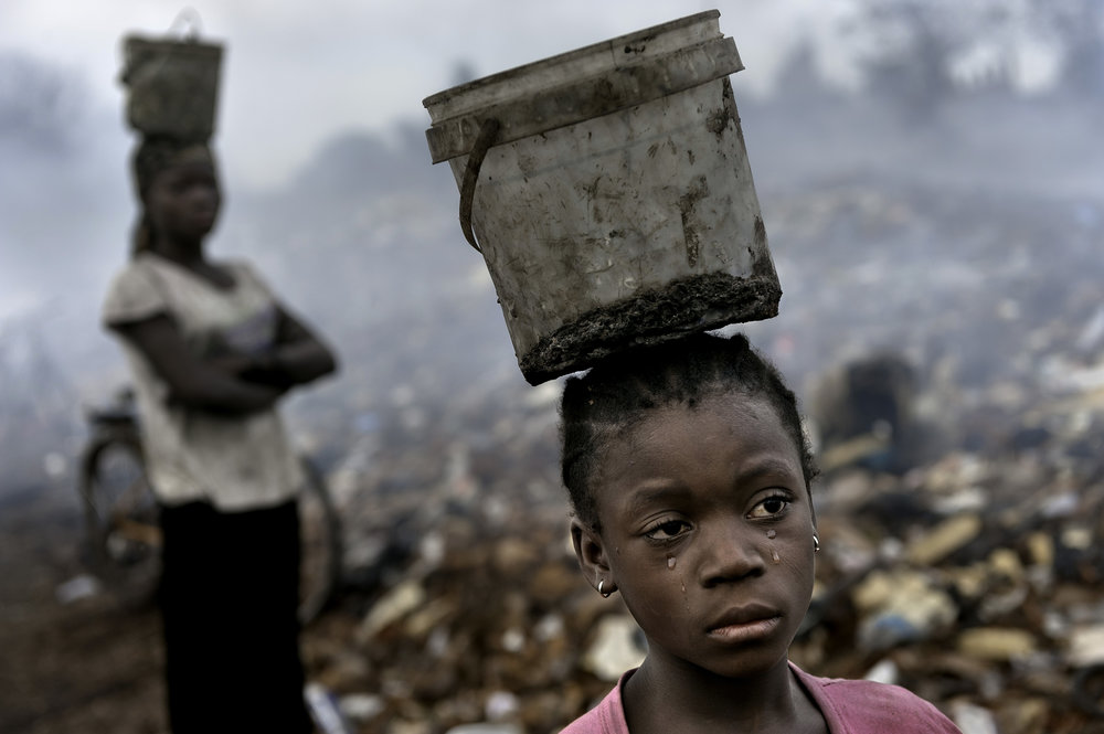Fati, age 8, scavenges at an E-waste dump in Accra, Ghana