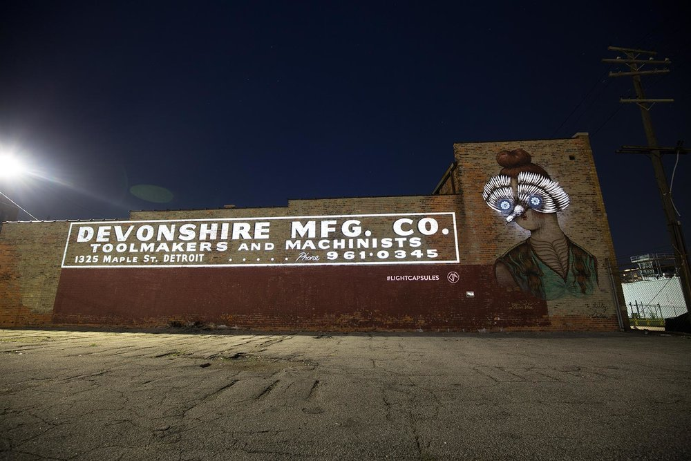 Artwork by Miss Van. Projection Mapping by Craig Winslow in Eastern Market, Detroit