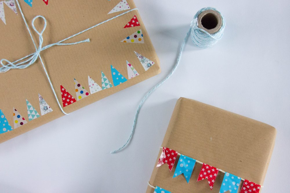 presents in brown paper and red and blue tags.jpeg