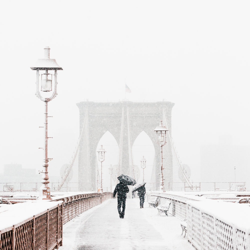 brooklyn bridge new york walking snowstorm dumbo downtown umbrella