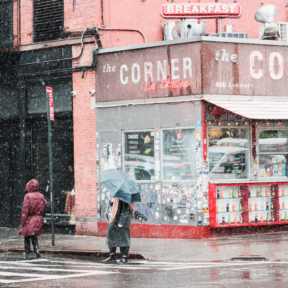 the corner mexican tacos food new york lafayette soho downtown snowstorm umbrella woman