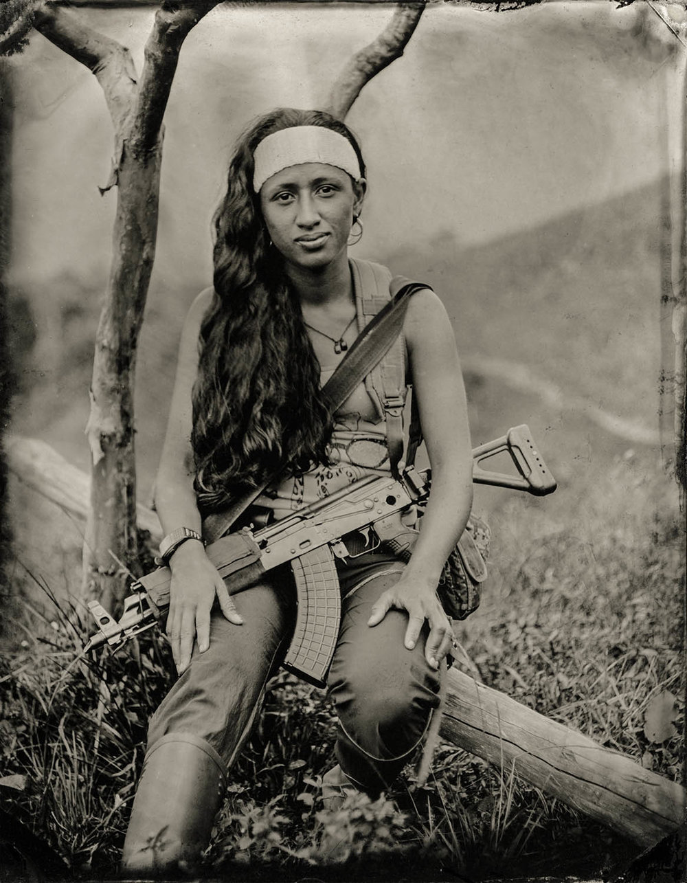 Maritza - By: Zach Krahmer  www.zachkrahmer.com   I made my first plates in mid-2016 during a one day workshop with Portland based photographer Ray Bidegain  The image of Maritza comes from, and represents a larger series of 80 plates of the 53-year old Colombian guerrilla army, FARC, in the early weeks of 2017 before they formally demobilized. The plates were made within various camps in remote areas of the mountainous Andean jungle, that were only accessible by mule.  I chose to make this work because the narrative presented in the news is simple, and I wanted to learn about the complex and dynamic motivations of individuals on this side in the Colombian Civil War. I chose to work with collodion because the process engages the sitter with the photographer, and requires collaboration.  Whether securing access, acquiring chemistry in a remote area, or innovating ultra mobile set ups, the series took international coordination between many groups of people in order to happen. Be sure to check out Vela Colectivo, who secured access, and Camilo Sabogal who assisted with acquiring chemicals in Colombia.