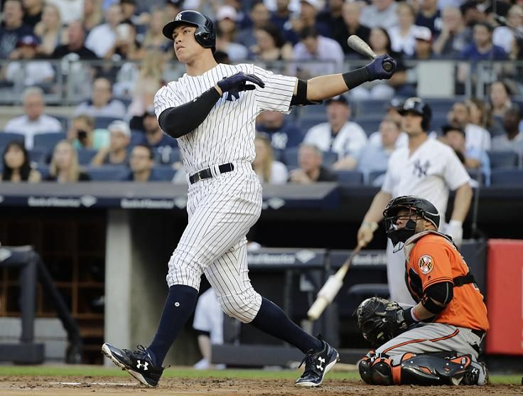 Aaron Judge watches a first inning homerun sail over the wall against the Orioles
