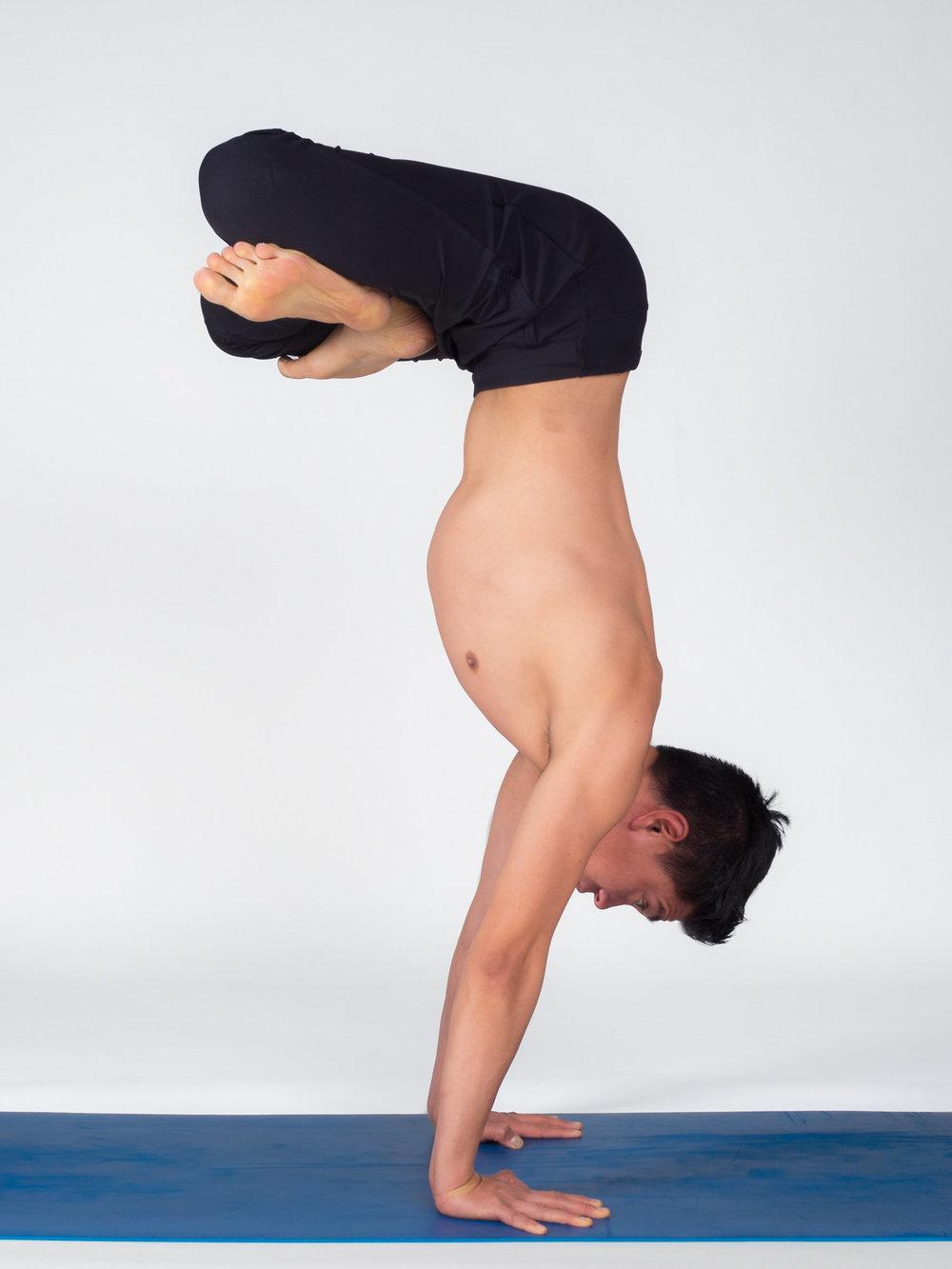 Andrew-Handstand Lotus.jpg