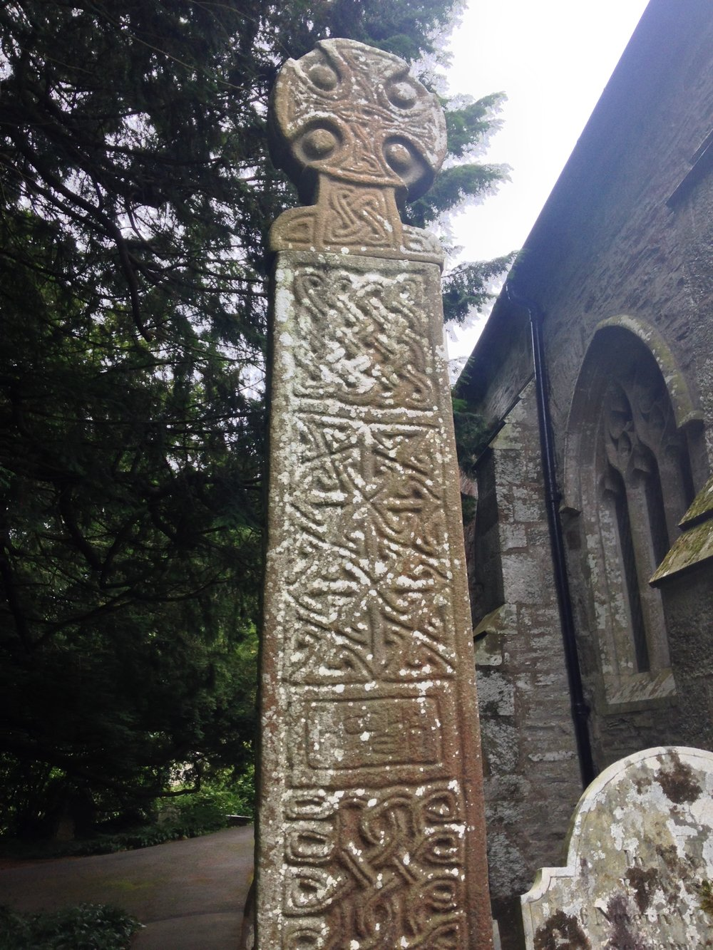 "Nevern Cross from the 10th or 11th century. The current church next to it was built built during Norman times, on top of the church founded by St Brynach in the 6th century. The mysterious ""Bleeding Yew"" Tree in the churchyard is a holy site of the Welsh goddess Cerridwen."