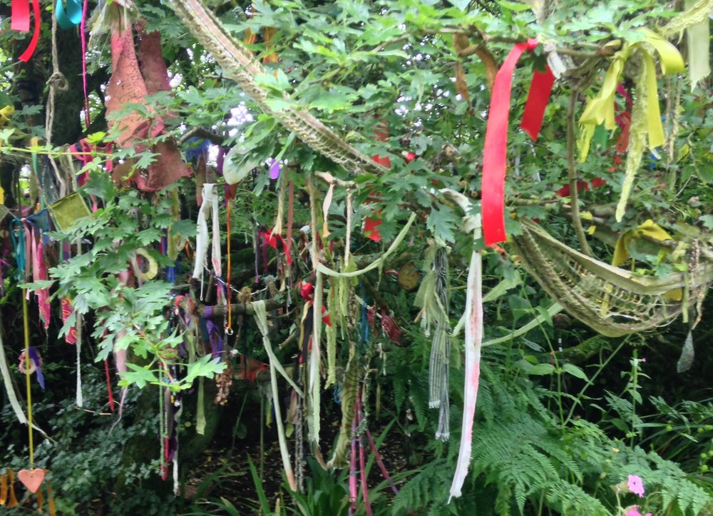 A clootie tree in Britain. Trees near holy sites, especially sacred water sources, are frequently gifted with ribbons, strips of cloth, and other objects, with prayers and wishes.