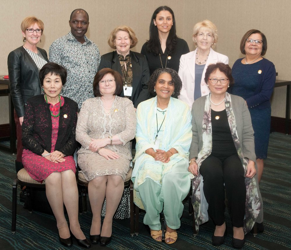 Front row, left to right: Karen Liu, Diane Whitehead, Guylaine Richard (former Board member), and Christine Chen. Back row, left to right: Julie Nicholson, Fortidas Bakuza, Elisabeth Shuman, Maryam Sharifian (former Board member), Nancy Brown (former Board member), and Pilar Fort.