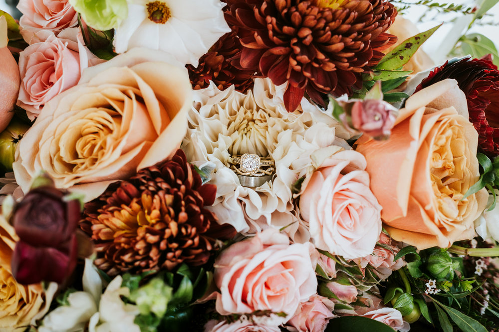 October 13th was such a perfect day. Laura and Brett tied the knot at The Manor House in Littleton with a beautiful brunch wedding. This bouquet is by Amber Mustain Floral Design. I love the way the bridal and bride's maid bouquet differed with a slight color change. -
