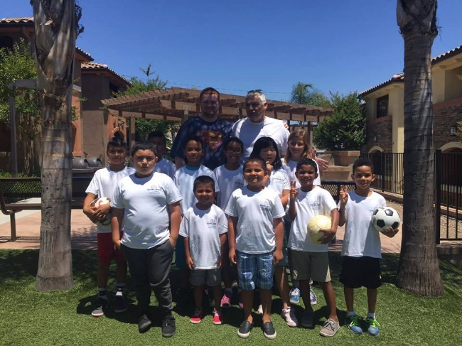 Juli Veee and his group of young soccer players at Chelsea Investment's  Cedar Creek apartments  in Santee.
