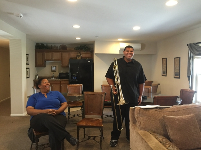 Terrence Patridge and his mother Thérèse Davis in the Community Room at The Landings in Chula Vista.