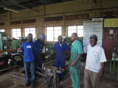 Brother William posing with the students having fabricated the press successfully