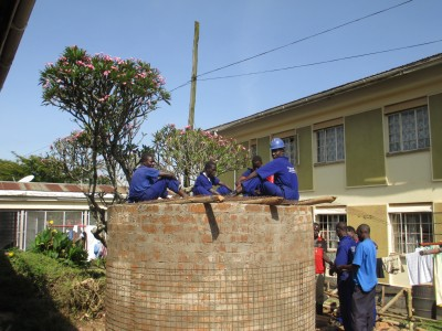 The students of St. Josephs Technical Institute busy learning the skills of water tank construction