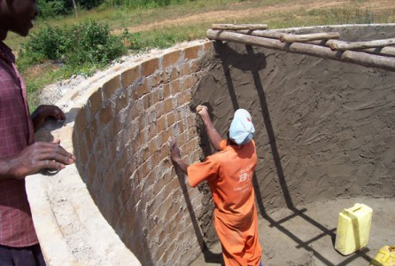 Brick by Brick Mason working on a recently constructed rainwater harvesting tank.