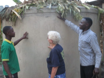 Marianne Martin Peace crps volunteer looking at the constructed water tank