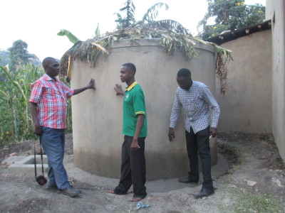The coordinator Brick by Brick Uganda monitoring the constructed water tank