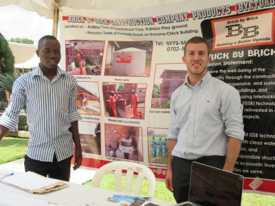 Brick by Brick Construction Co. Manager David Mutesaasira and Engineering Intern James Murduca at UWASNET Conference in Kampala