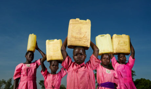 Ugandan children carrying water