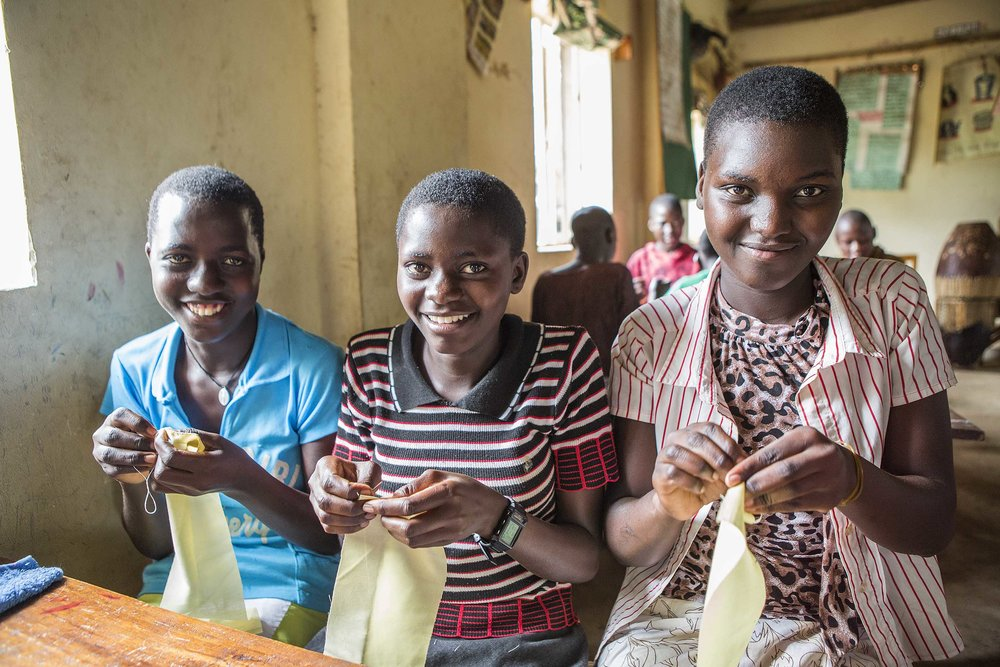 Young women learning to make their own set of reusable menstrual pads