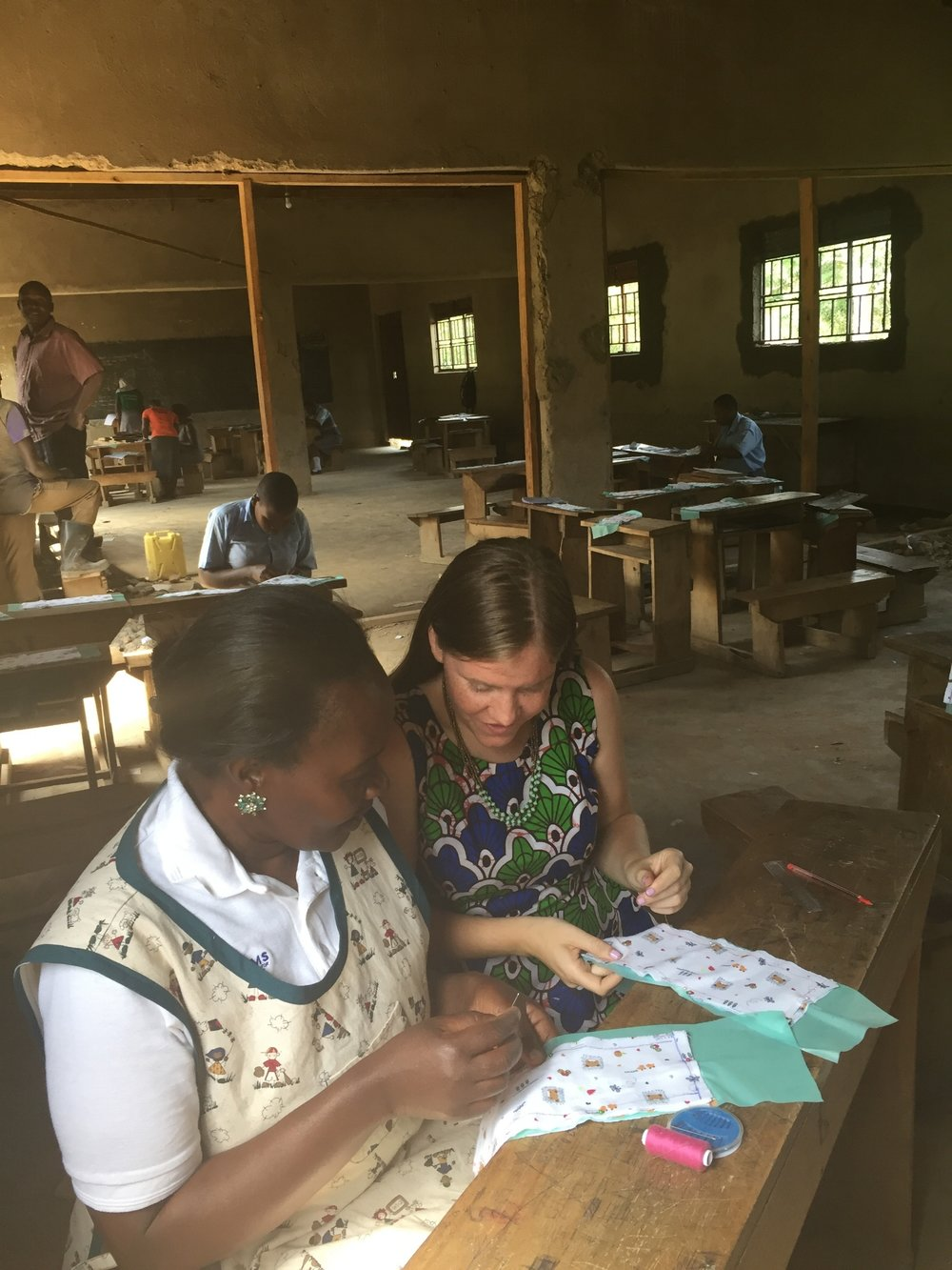 Liza making reusable menstrual pads with Health Educator Suzan Kyambadde