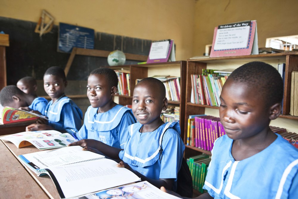 Our students reading at their new school library.