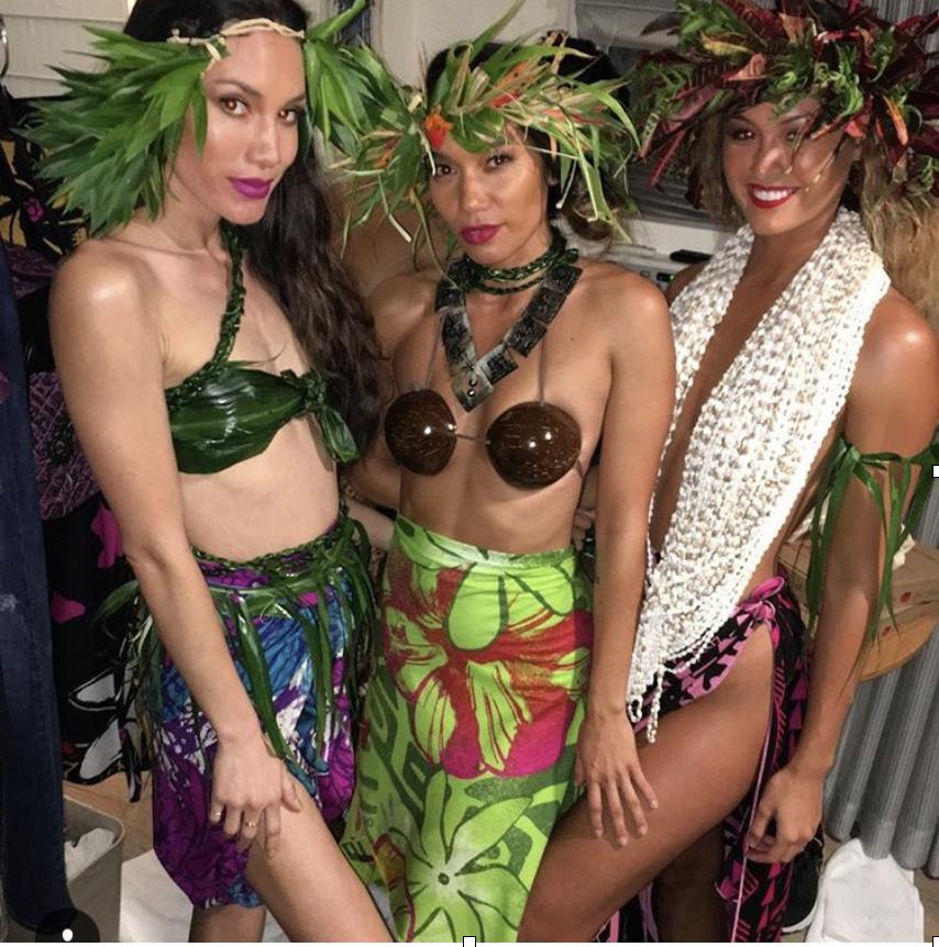 Stunning models Jade Alexis (center) and Sarah Baumgartner (right) strike a pose backstage