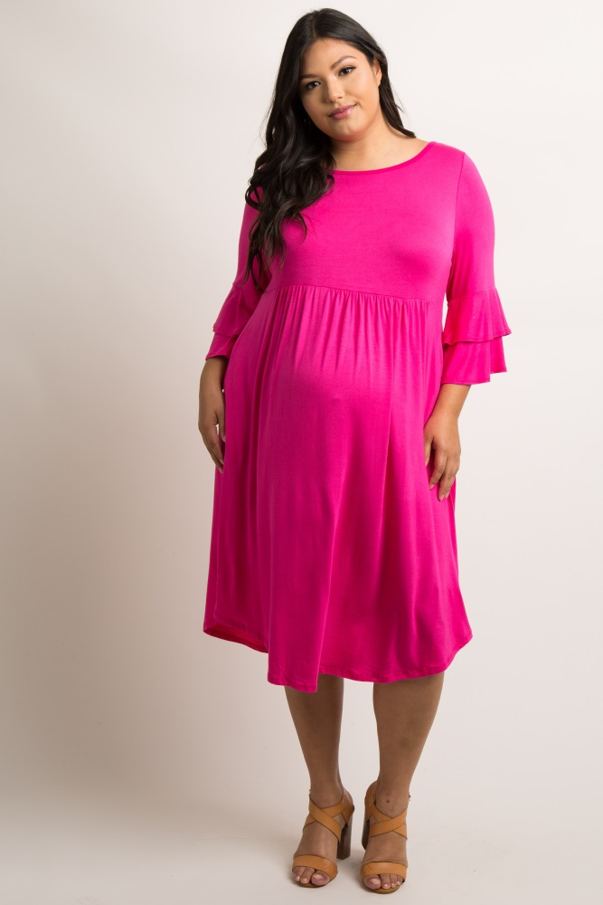 Magenta Crisscross Back Babydoll Plus Maternity Dress  $57 - PinkBlush  A solid hued plus size maternity dress featuring a crisscross back, babydoll style pleated details, a rounded neckline, 3/4 sleeves with a layered flounce trim, and two side pockets.