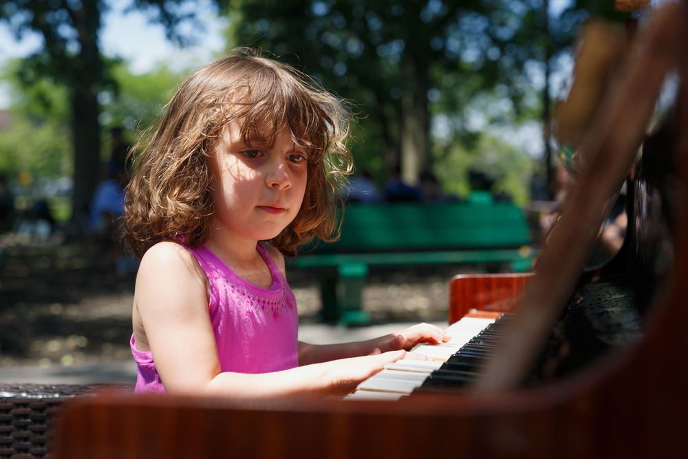 This is Chelsea's first performance at the Hatch Shell. Definitely an un-expected sight to see this very weathered piano next to some park benches. Chelsea jumped at the chance to play the oddly tuned and badly warped piano.