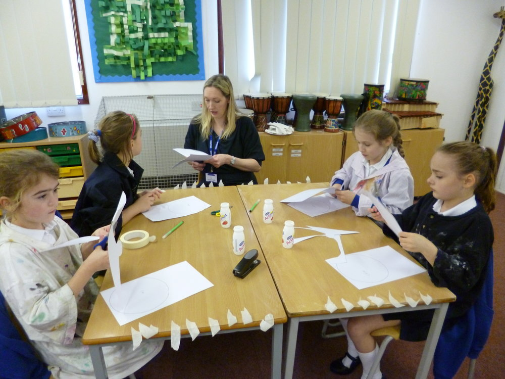Year 3 working with an adult to make their volcanoes.