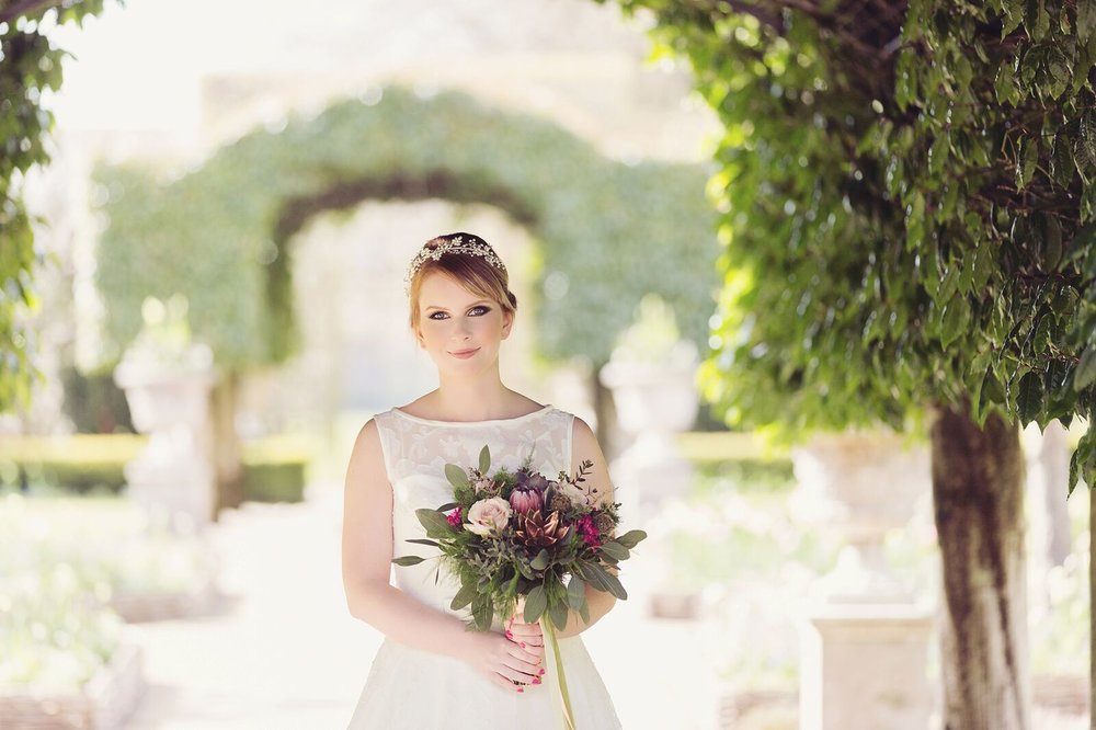 Holker bride in garden.jpg