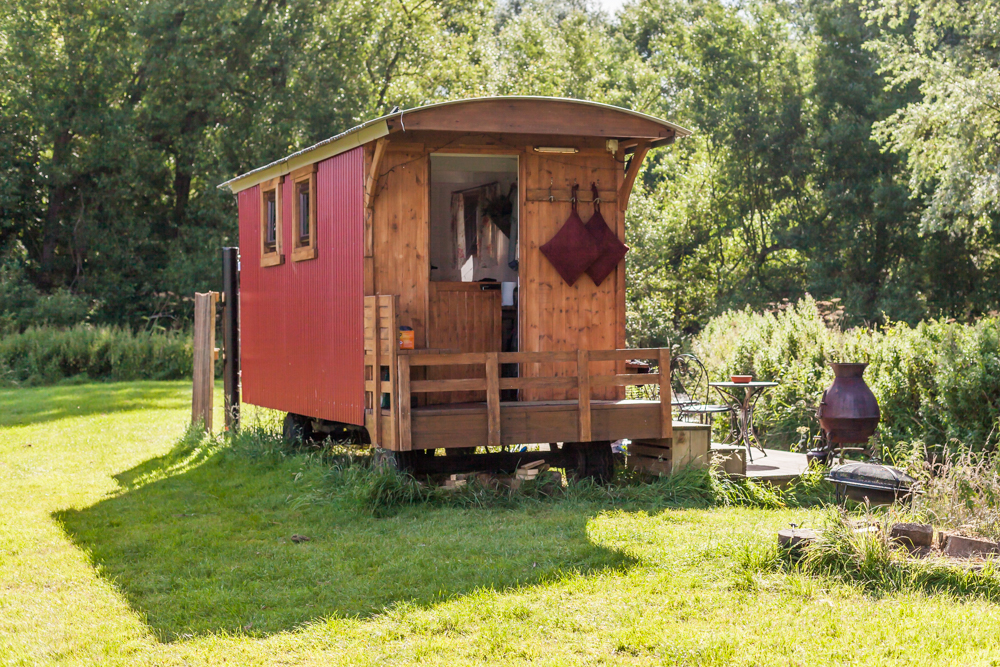 Show the shepherd's hut in it's beautiful location