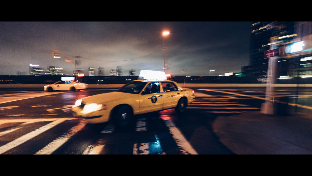Sony A7Rii + Voigtlander SUPER WIDE-HELIAR 15mm F4.5 III - ISO 6400 1/13 - This corner was way darker then it appears in this image. I used the slow shutter to my advantage and captured some motion and love the results. Yellow taxi's have given me endless inspiration over the years...
