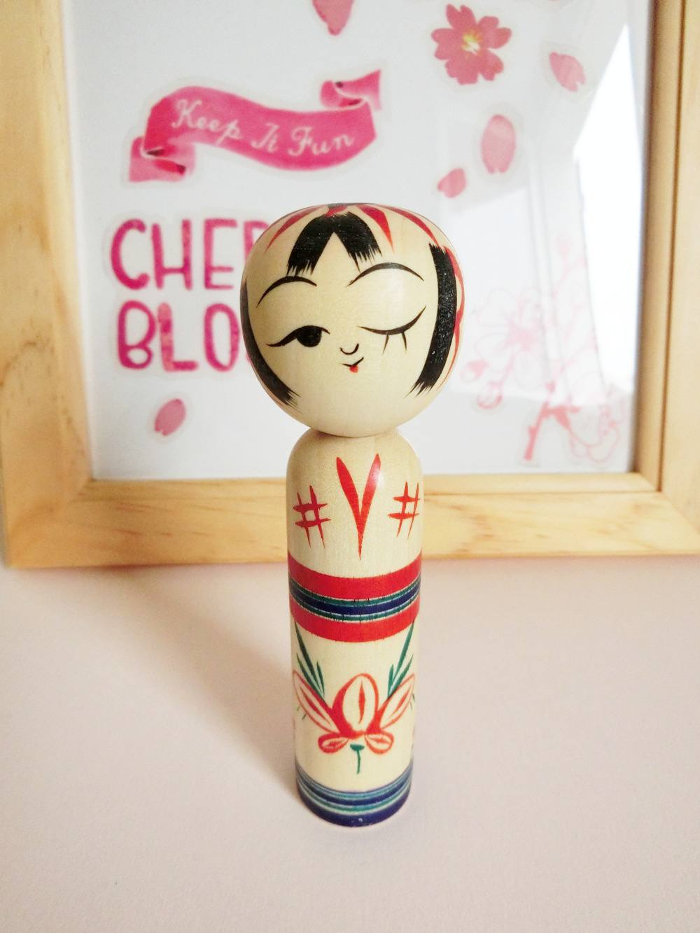 Back in stock! - Wink kokeshi doll by Kanou Hiroshi