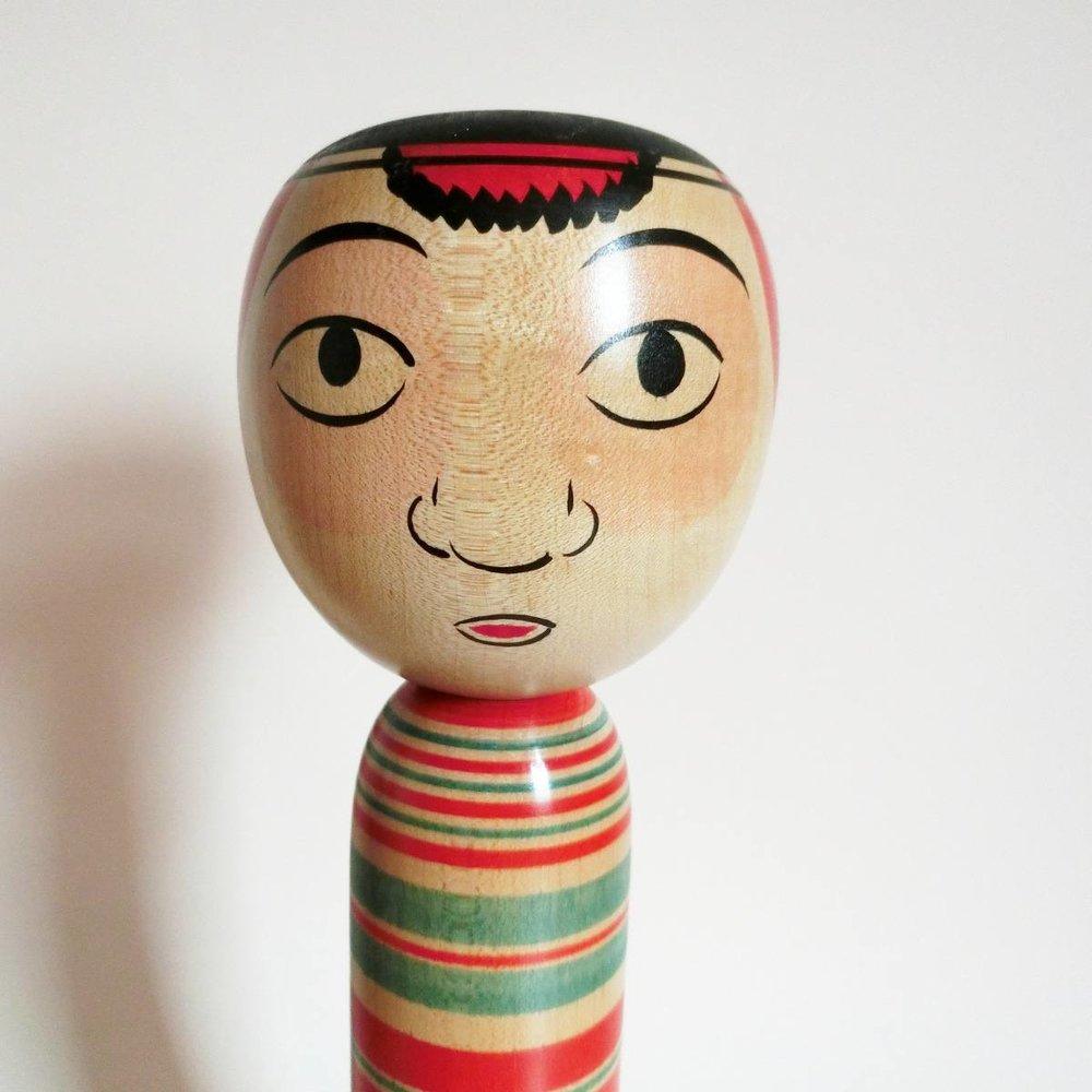 A Takobozu kokeshi face
