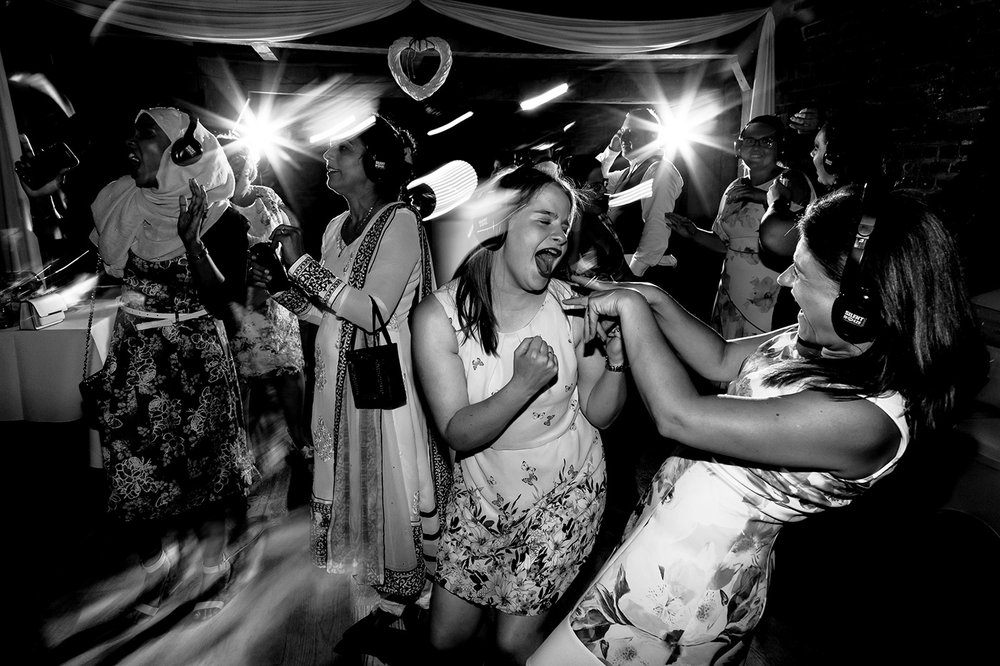 Guests dance to the silent disco at Tewinbury Farm in Hertfordshire.