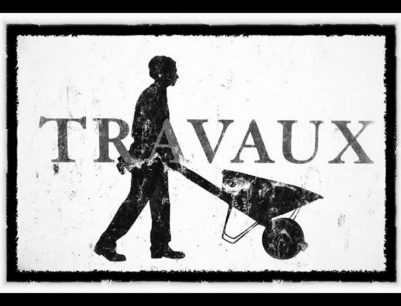 "A black graphic silhouette of a man pushing a wheelbarrow on a white background. With the word ""travaux"" across the image.."