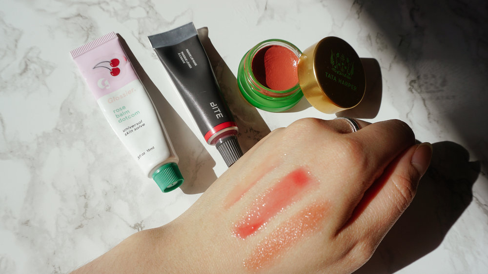 Shown here from left to right: Glossier Rose Balm Dot Com, Bite Beauty Agave Lip Mask in Smashed, Tata Harper Volumising Lip and Cheek Tint in Very Popular