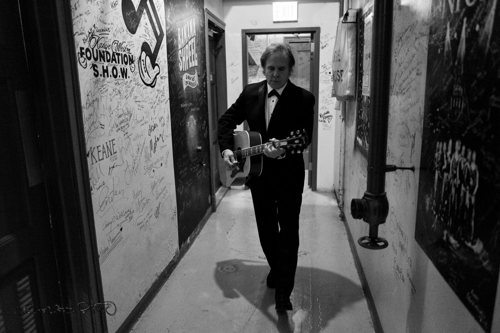 Mike Wanchic tunes his guitar backstage.