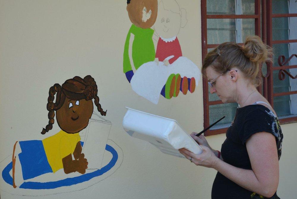 Painting murals on duplex 2