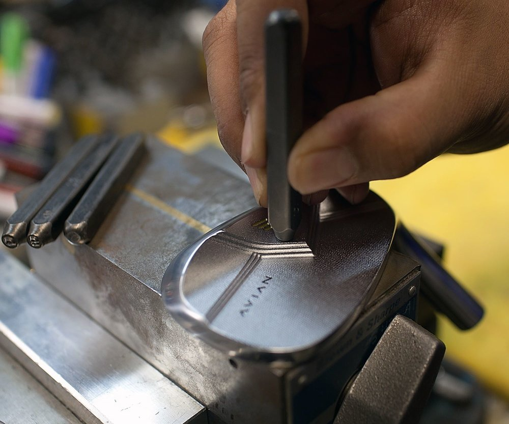 Avian wedge personalization by hand stamping initials.