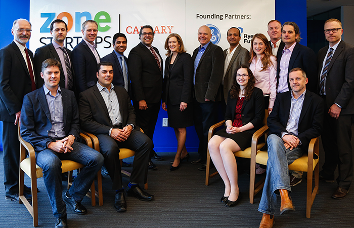 The Stream team on the left with Mayor Nenshi and Elyse Allan, President & CEO GE Canada in the middle. (Unfortunately Dumitru's eyes are closed - but that doesn't mean he's not excited to be there!)