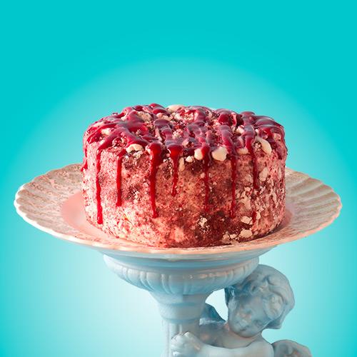 RED RAPTUR  Vanilla soft serve, red velvet cake, cream cheese icing, raspberry sauce, meringue crumble
