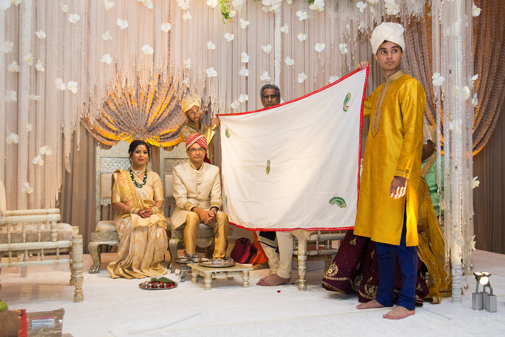 Le Cape Weddings - South Asian Wedding - Puja and Kheelan - Ceremony Adds 12.jpg