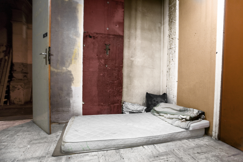 A lone bed lies on the floor. Most beds this size are shared by two men or women(separately).With no heating available, and few blankets to spare, sleeping is not an easy task in the Collective.