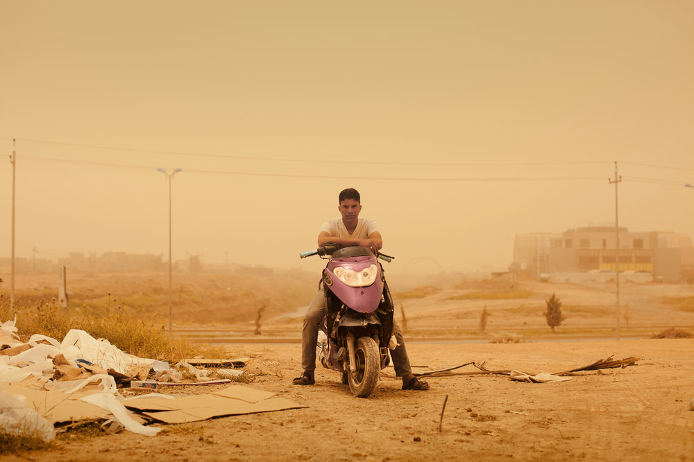 Aziz during a sandstorm. Erbil, Iraq.